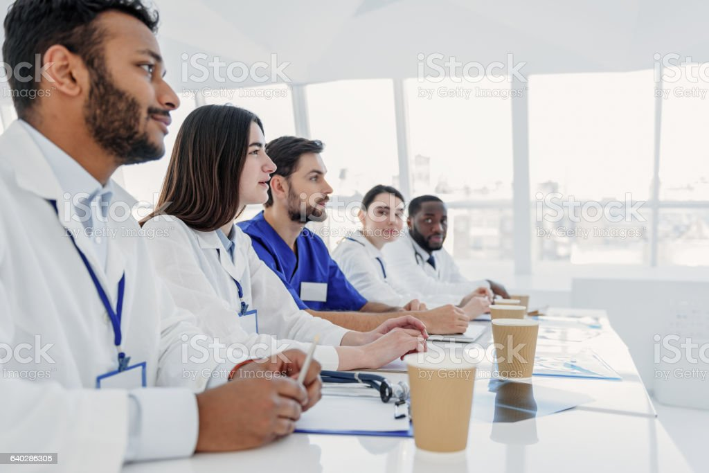 Smart interns analyzing human illness stock photo