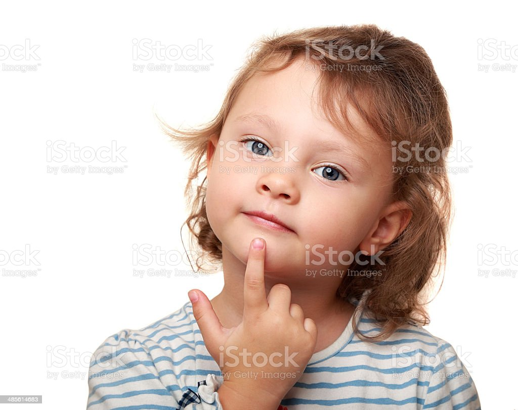 Smart kid girl thinking and holding finger under the face stock photo