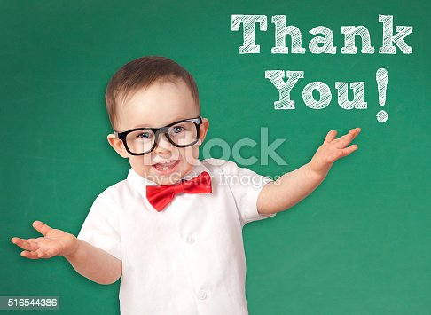 516544386 istock photo Smart Kid with a Thank You message 516544386