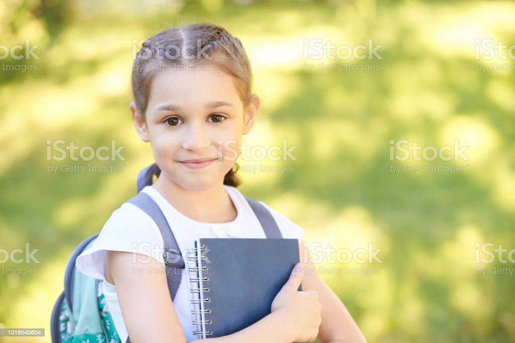 smart kindergarten. blue reading. back to school together with handsome friends. First grade question stock photo