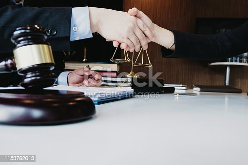 smart lawyer handshake with advice in the office before considering the judgment, lawyer concept