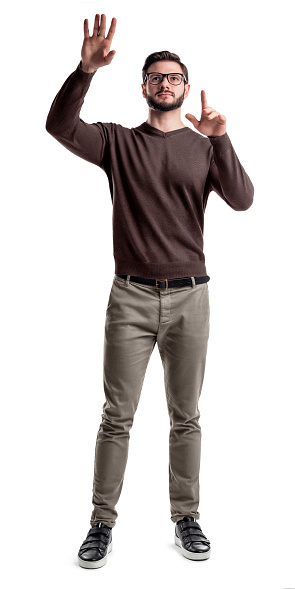 istock A smart looking bearded man looks up and holds his hands as if manipulating a large touch screen 987270424