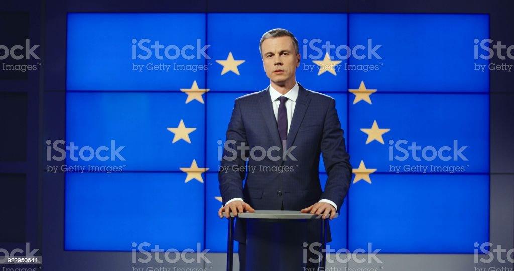 Smart male news anchor presenting European news stock photo
