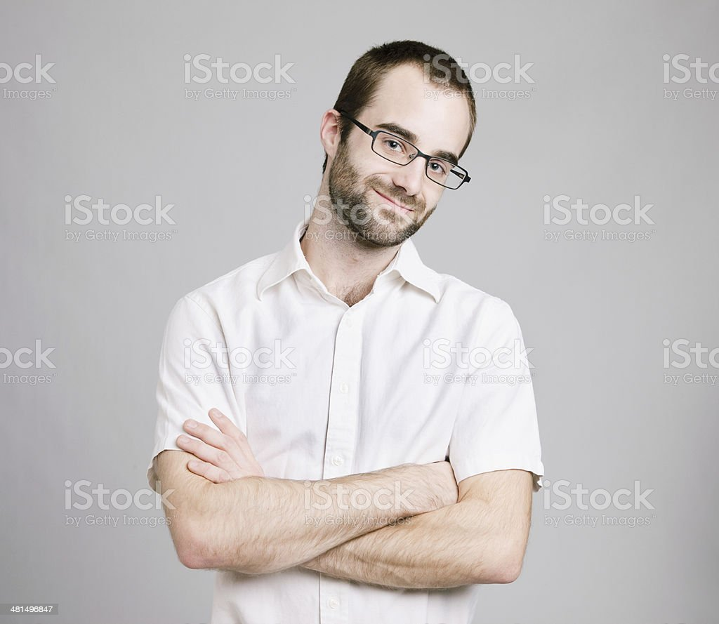 Smart man arms crossed stock photo