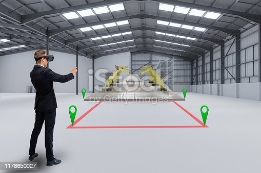 istock smart manufacturing ,industry 4.0, 5.0 technology concept, man use augmented mixed virtual reality technology to manage, simulation to install new machine in the factory predict, analytic 3d rendering 1178650027