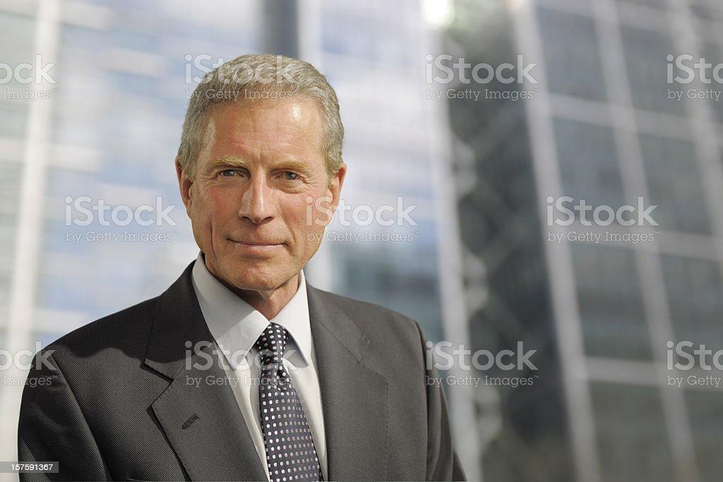 smart mature businessman in city stock photo