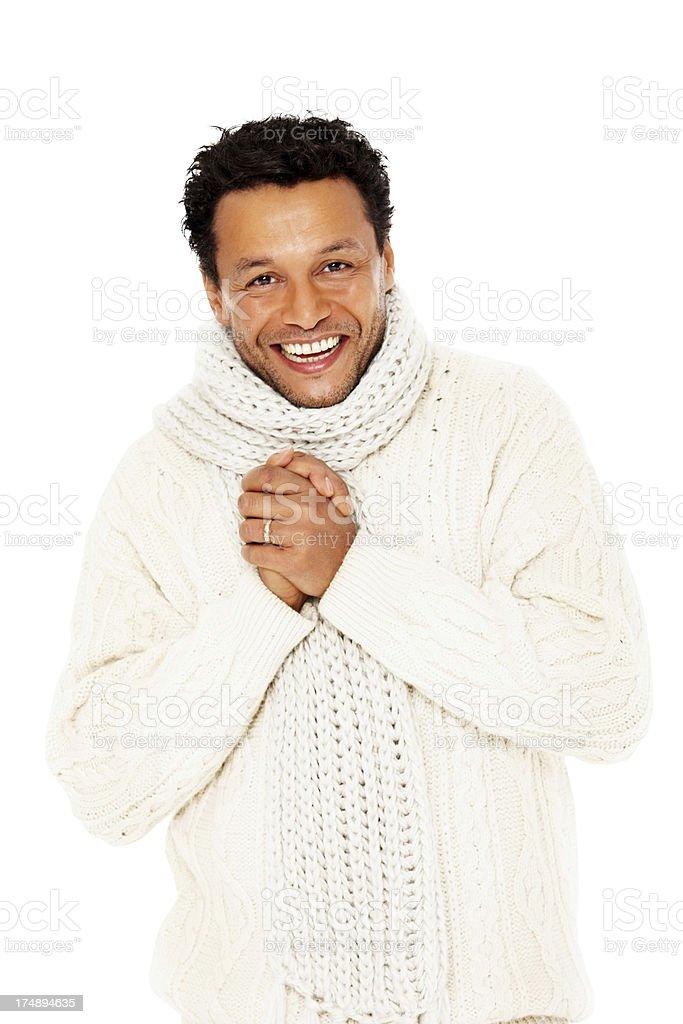af9eaf2210 Élégant mature homme en vêtements d'hiver souriant contre blanc photo libre  de droits