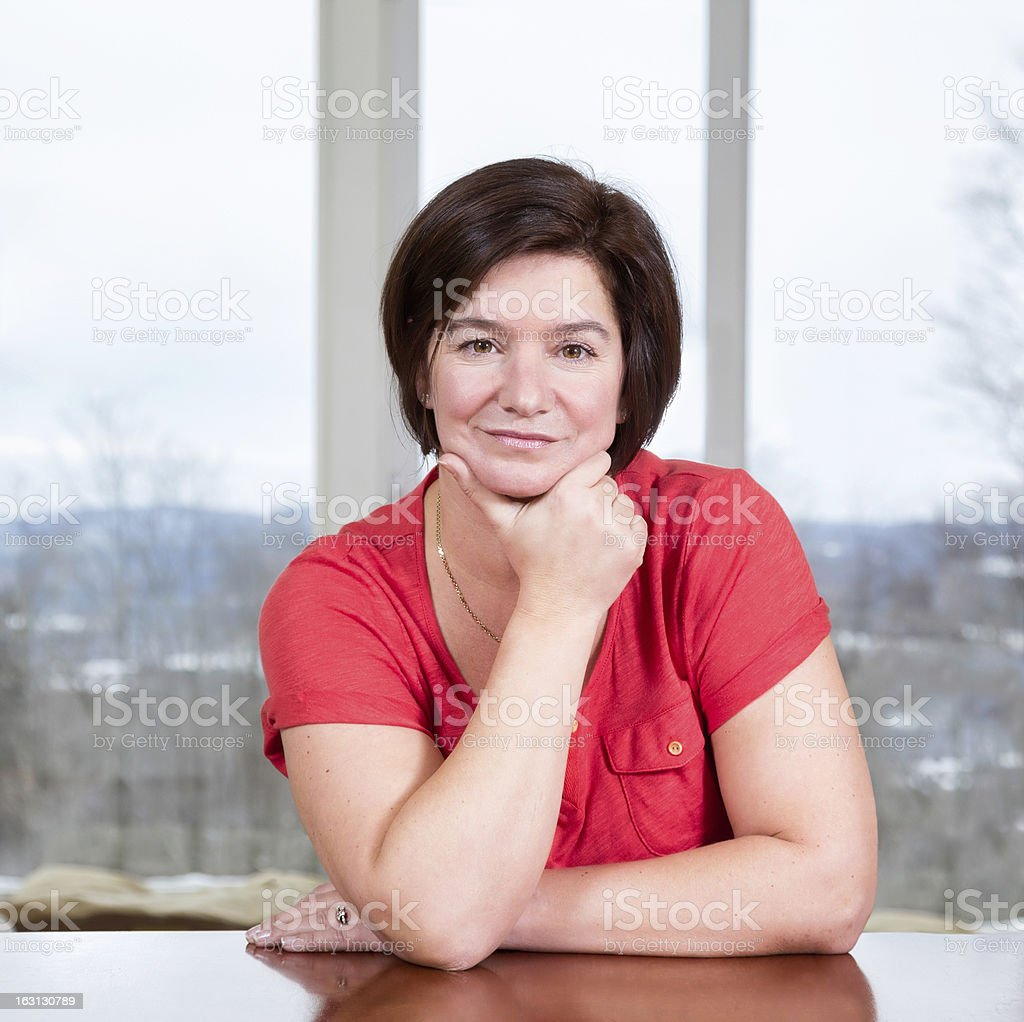 Smart mature woman portrait at home stock photo