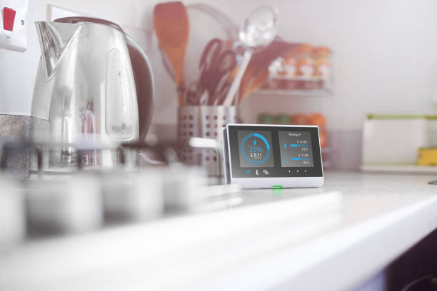 Smart meter in the kitchen Smart meter in the kitchen of a home showing current energy costs for the day  Design on screen my own. Please see property release. home automation stock pictures, royalty-free photos & images