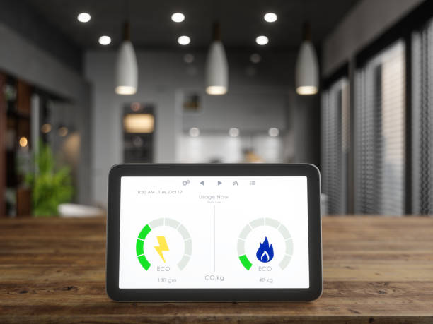 Smart Meter On Desk In The Kitchen Smart Meter On Desk In The Kitchen smart thermostat stock pictures, royalty-free photos & images