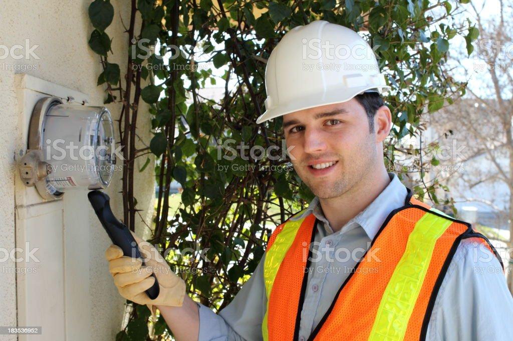 Smart Meter Technician Callibrates Device Horizontal royalty-free stock photo