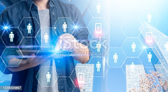 1127866562 istock photo Smart mobile gadget technology online video call meeting chat, social network IOT internet of thing hi-tech futuristic virtual hologram communication, online future lifestyle work from home technology 1223005867