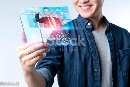istock Smart mobile gadget technology online video call meeting chat, social network IOT internet of thing hi-tech futuristic virtual hologram communication, online future lifestyle work from home technology 1223005878