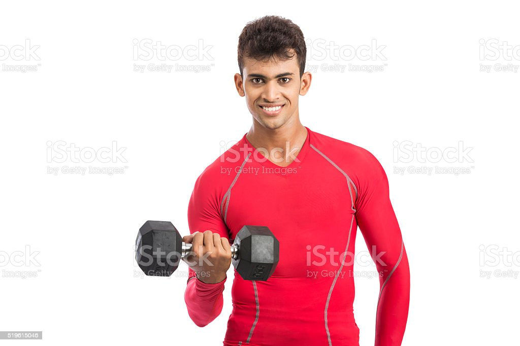 Smart muscular guy doing work out with dumbbells stock photo