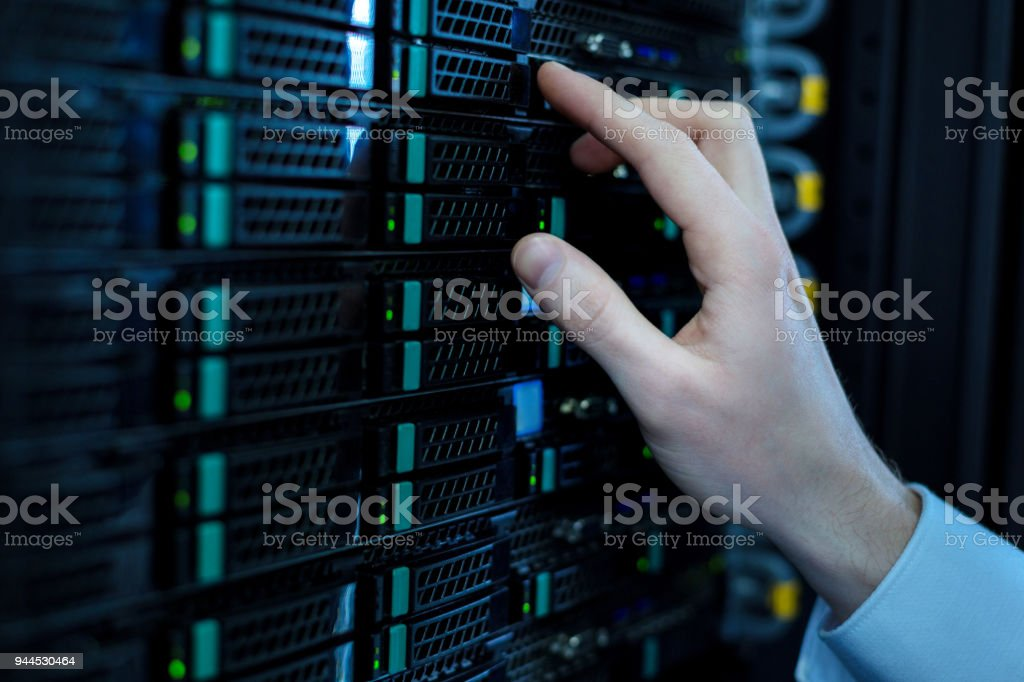 Smart operator pressing right buttons stock photo