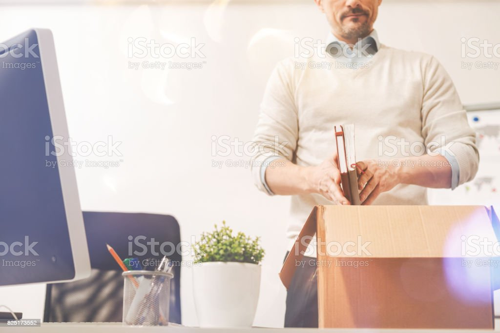 Smart persistent employee taking his notes with him stock photo