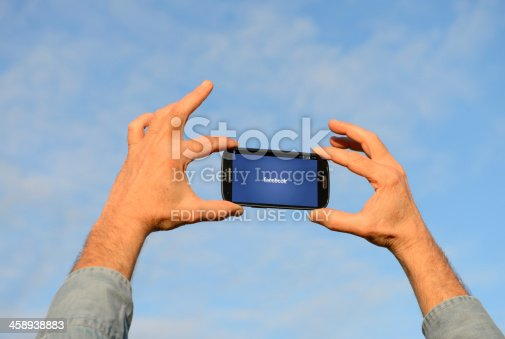 istock Smart Phone against Blue Sky 458938883
