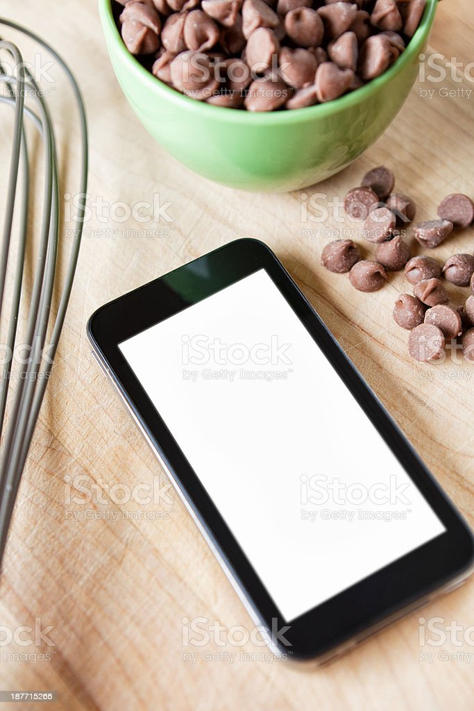 Smart Phone and Baking Supplies royalty-free stock photo