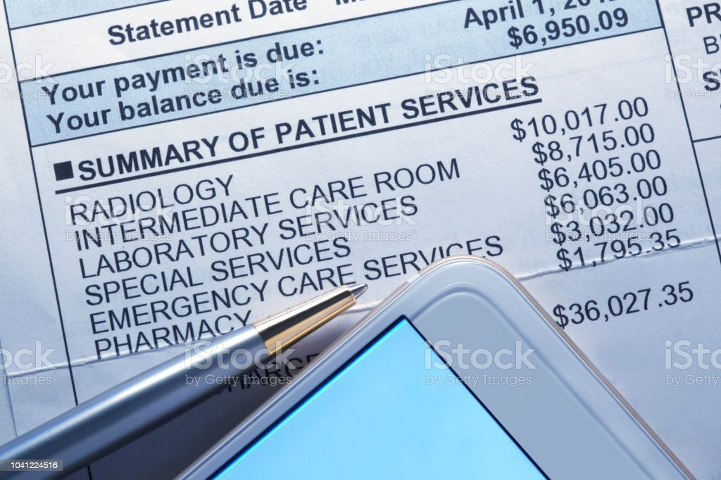 Smart Phone And Ballpoint Pen On Top Of Medical Invoice stock photo