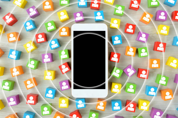 Smart phone and colorful blocks with human pictogram stock photo
