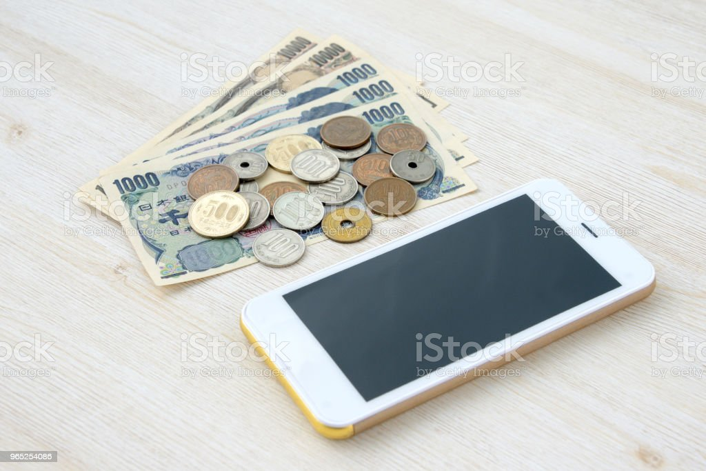 Smart phone and Japanese money royalty-free stock photo