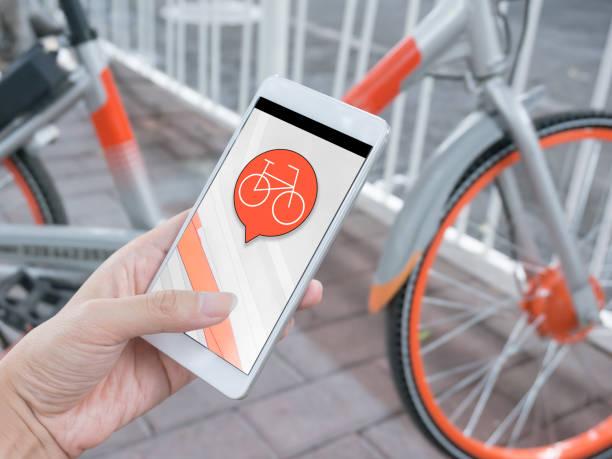 Smart phone and shared bikes stock photo