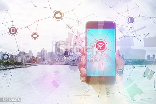 istock smart phone and smart city, wireless communication network 610128378