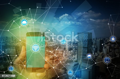 istock smart phone and smart city, wireless communication network 612621468