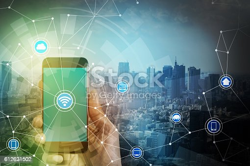 istock smart phone and smart city, wireless communication network 612621502