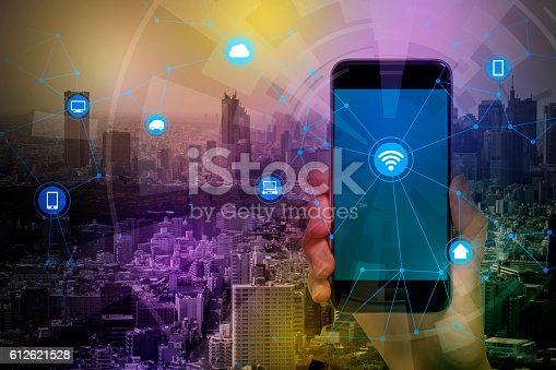 istock smart phone and smart city, wireless communication network 612621528