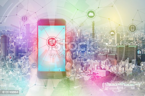 istock smart phone and smart city, wireless communication network 613749864