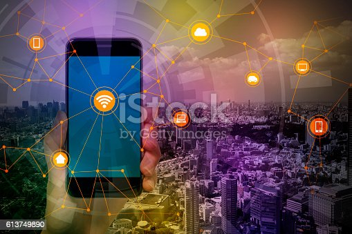 istock smart phone and smart city, wireless communication network 613749890