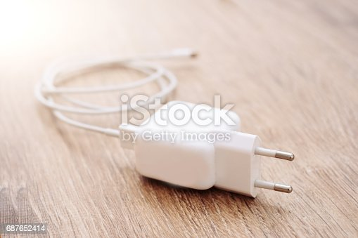 istock Smart phone battery charger isolated on office desk 687652414