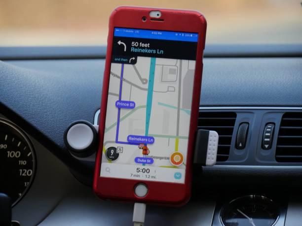 smart phone gps system - hand holding phone стоковые фото и изображения