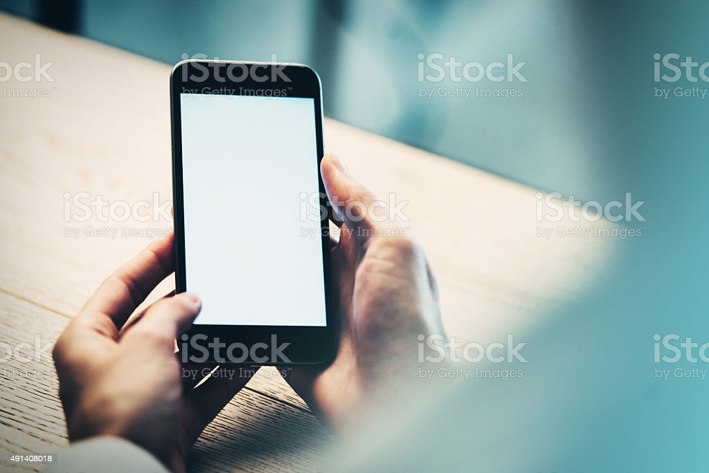 Smart phone holding in female hand stock photo
