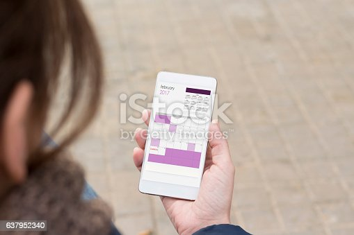 istock Smart phone holding in female hand. 637952340
