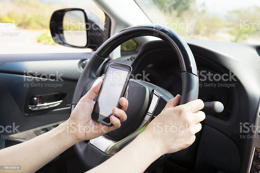 smart phone in hand  while driving stock photo