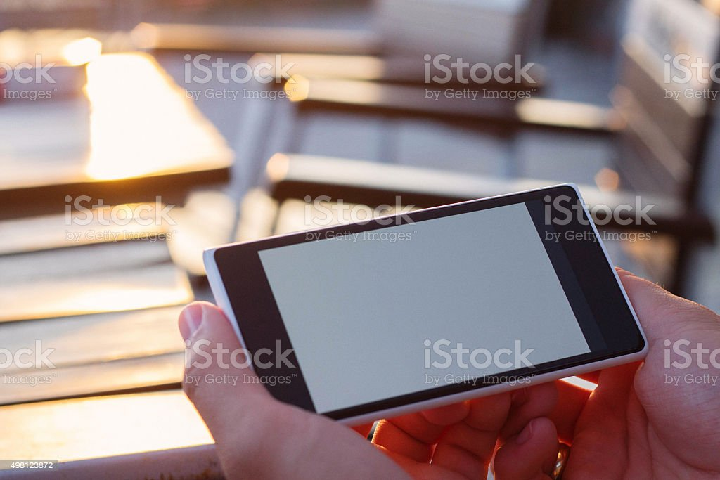Smart phone in hands with blank space stock photo