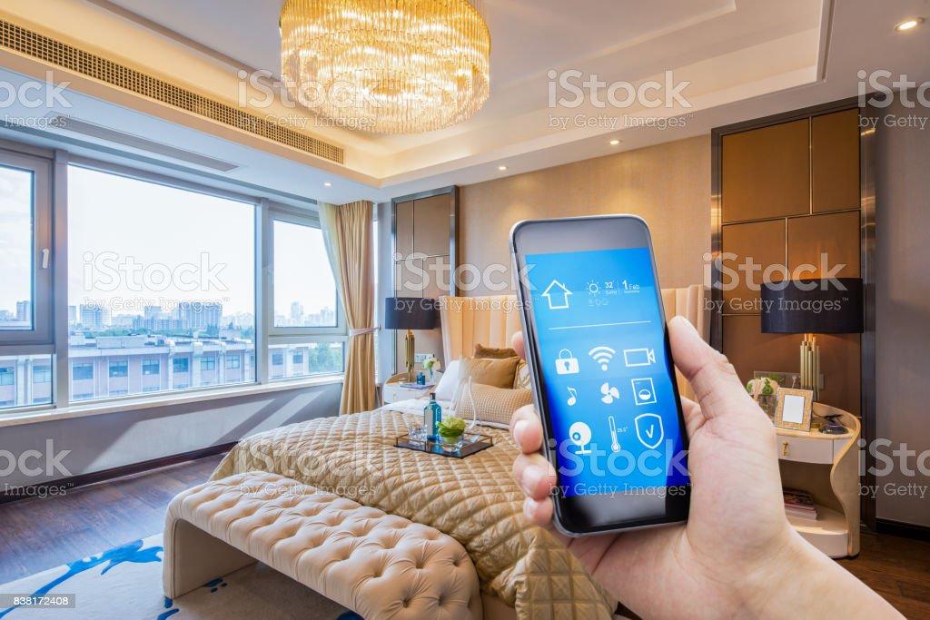 smart phone in modern bedroom stock photo