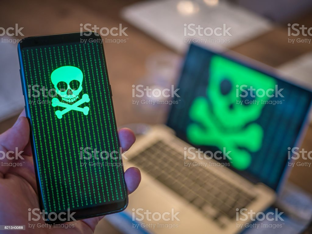 Smart phone is hacked with virus. Computer in background. Smart phone is hacked with virus. Computer in background. Business Stock Photo
