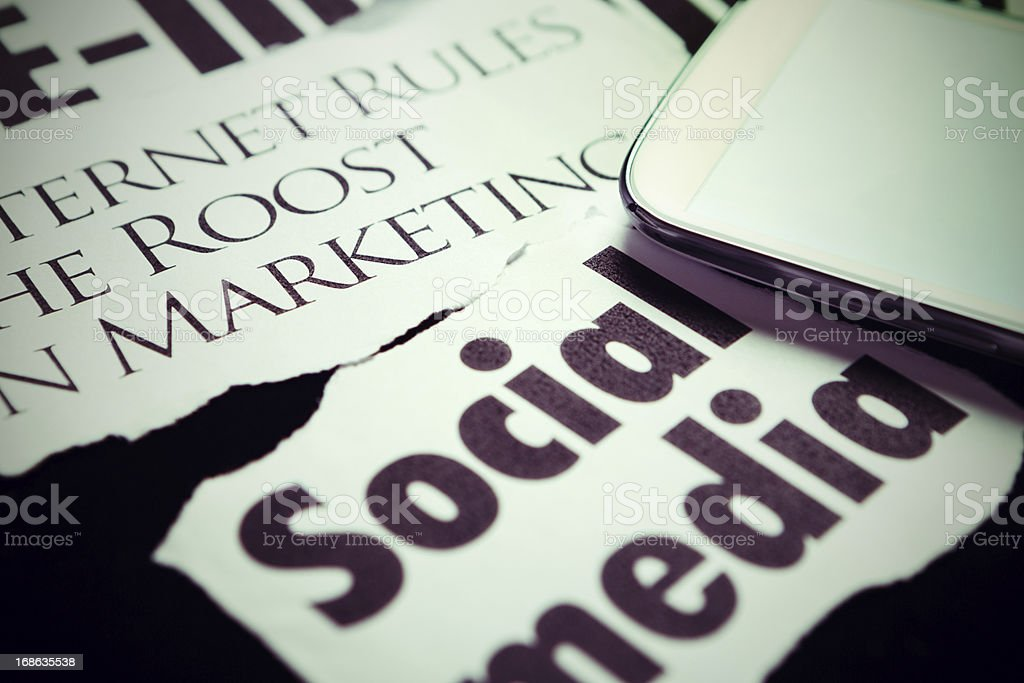 Smart phone on headlines about the importance of Social Media stock photo