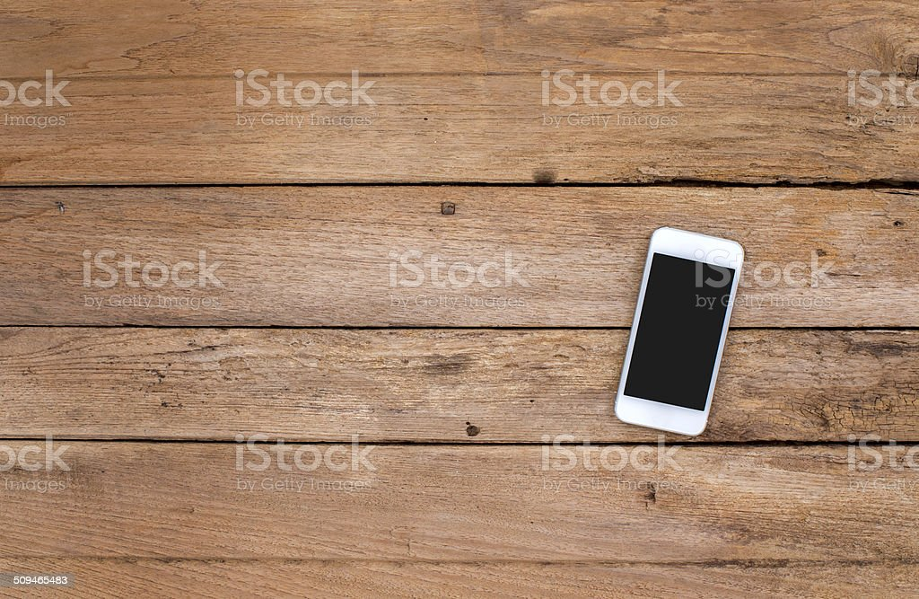 Smart phone on old wooden background stock photo