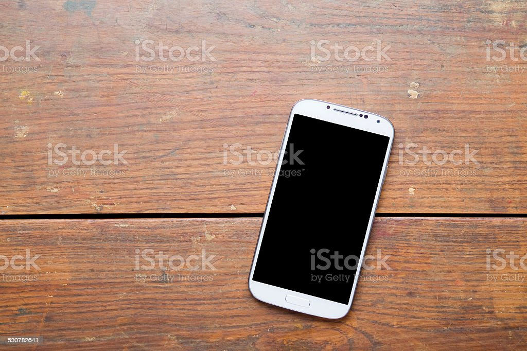 Smart phone on old wooden background XXXL stock photo
