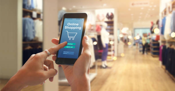 smart phone online shopping in woman hand. network connection on mobile screen. payments online. shopping mall department store background - app store stock photos and pictures