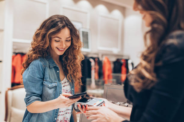Smart phone payment in a fashion retail stock photo