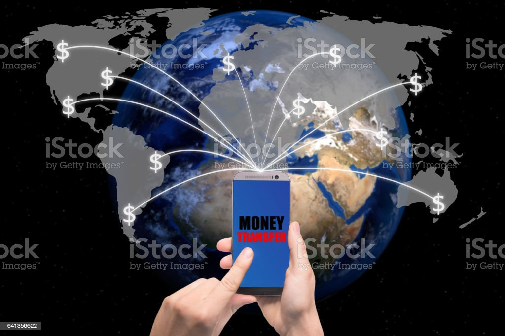 Smart phone sent money dollar from screen to global map. stock photo
