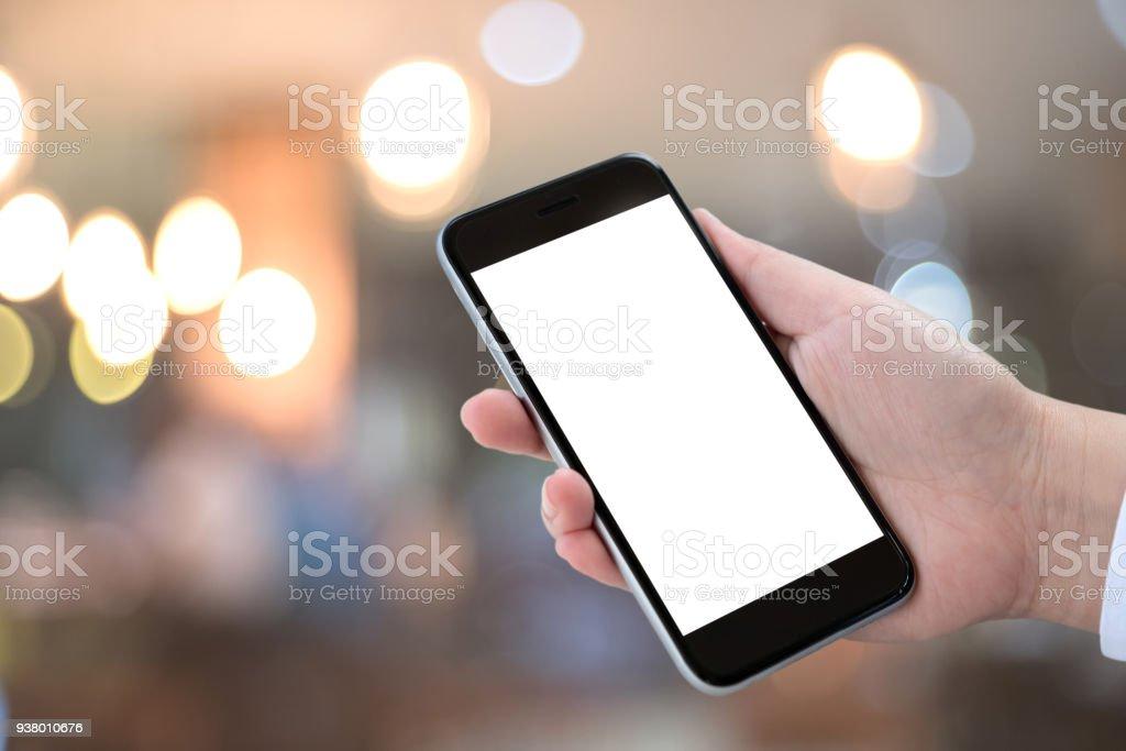 Smart phone showing blank screen in man hand at walk street,night...