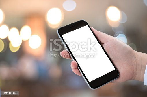 istock Smart phone showing blank screen in man hand at walk street,night light bokeh Background 938010676