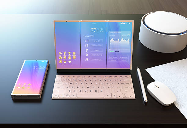 Smart phone, tablet PC, digital pen, keyboard and voice assistant Smart phone, tablet PC, digital pen, keyboard and voice assistant on a dark wood table. The tablet showing home energy management information. 3D rendering image. detach stock pictures, royalty-free photos & images