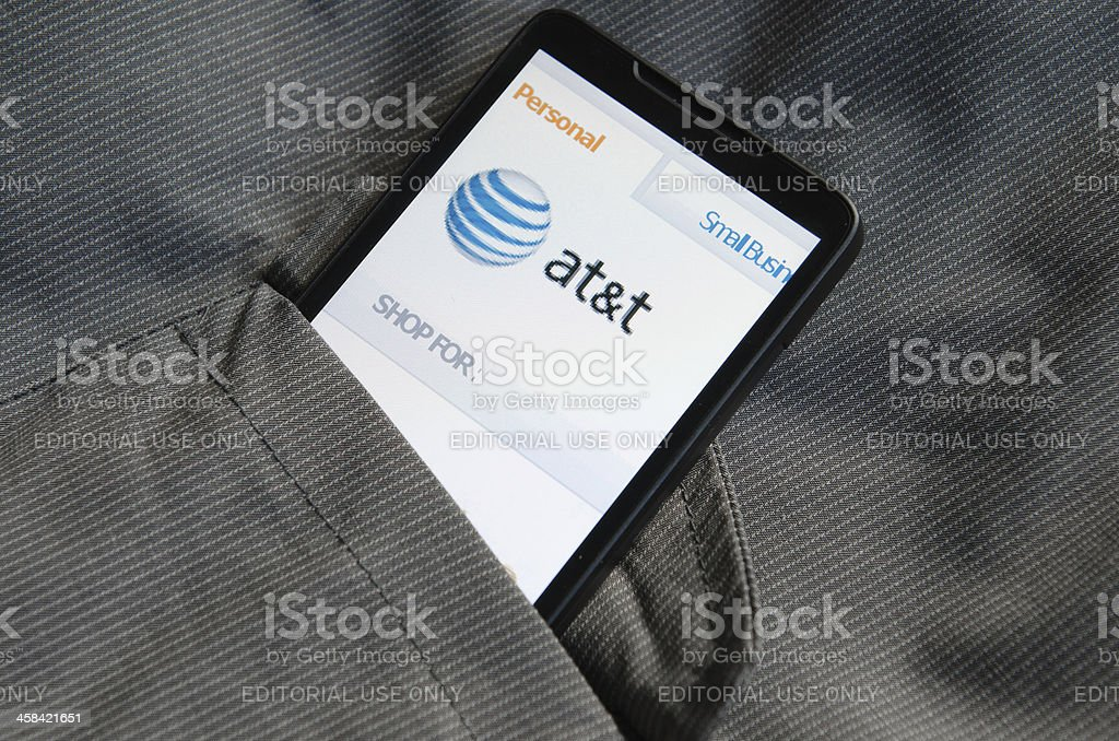 Smart phone with AT&T.com site in the pocket stock photo